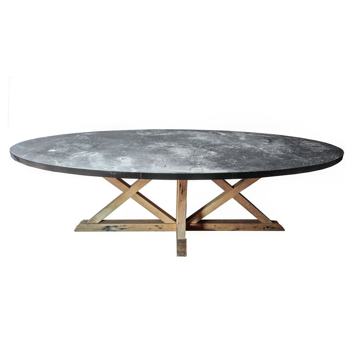 Love the lunar like finish of this zinc topped dining table