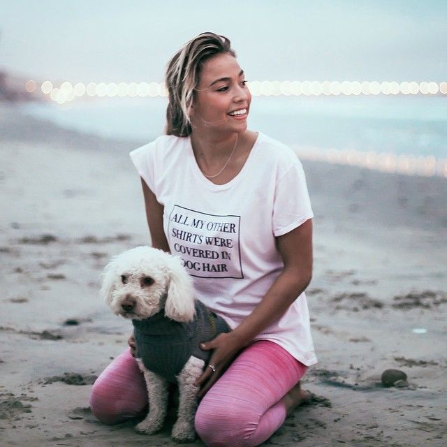 "Surfer/yogi Tia Blanco posing in #TheTreeKisser ""Dog Lover"" tee alongside her pup! Available at http://bit.ly/1cAttLu"