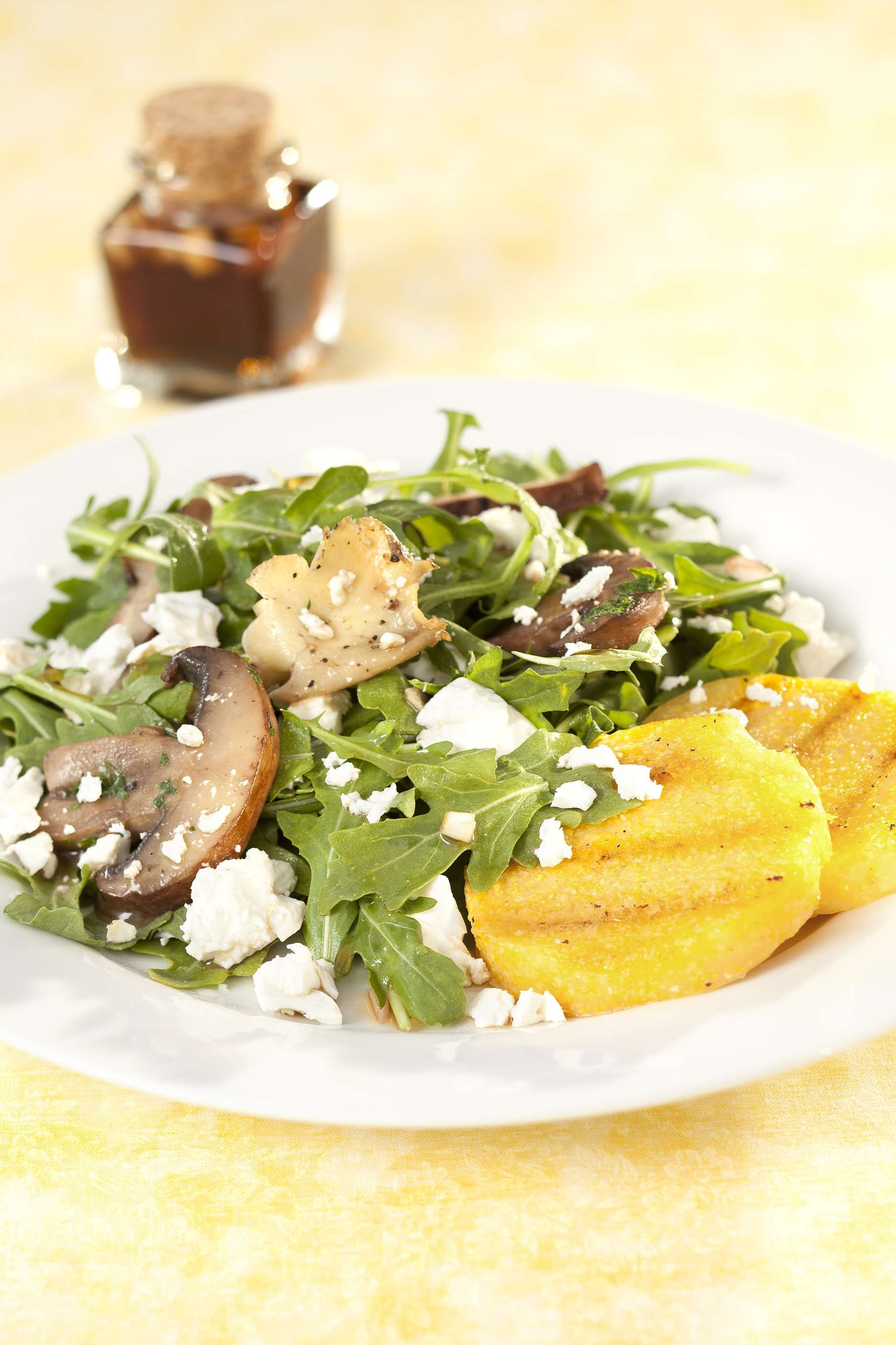 Grilled Polenta Rounds with Gourmet Mushrooms Salad and Feta featuring Président® Crumbled Feta