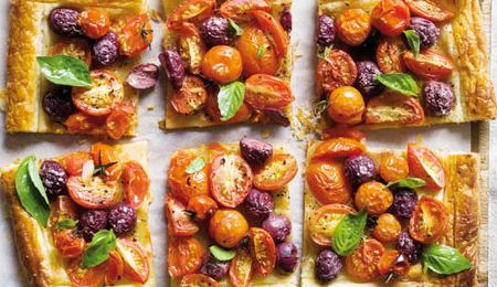 Cocktail Tomato and olive tart #recipe. A light family supper or a fuss free snack to feed a crowd.