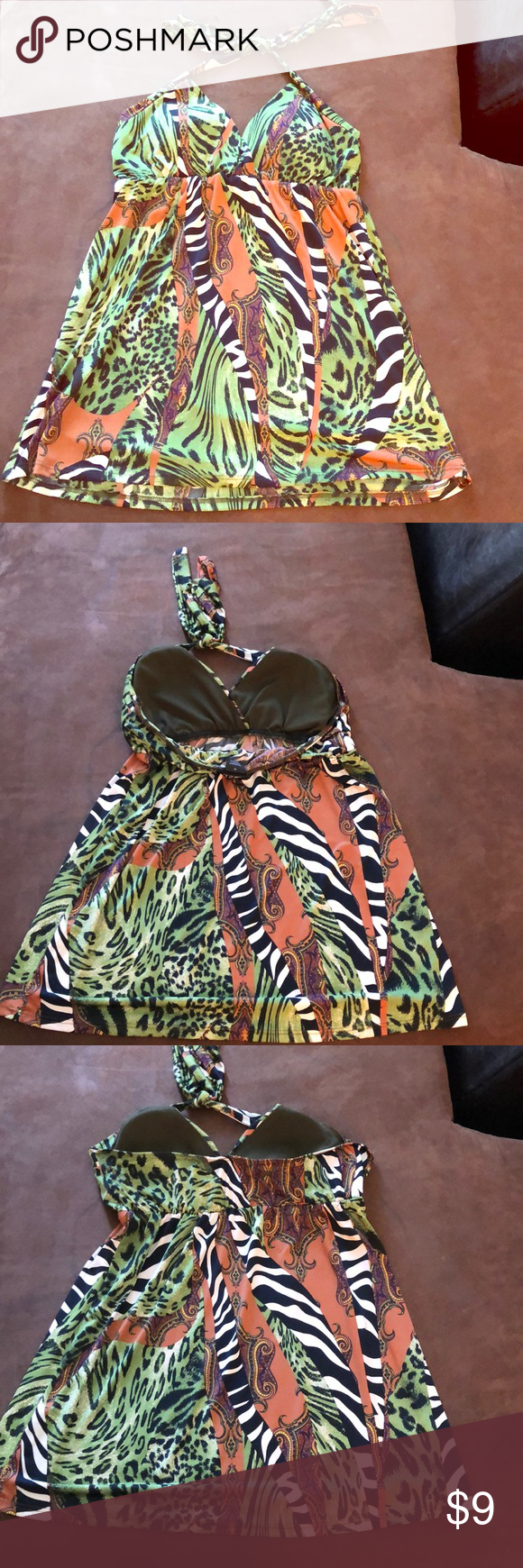 Jungle Patterned Halter Top Jungle pattern. Halter top style with padded cups for support. No bra necessary if you don't want. Stretchy for a good fit. New condition. Machine washable. Lay flat to dry. Elastic around the back to keep things where the need to be. Rue21 Tops #junglepattern