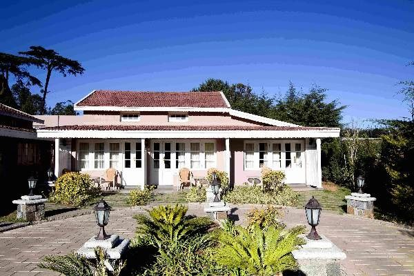 Derby Green Is Located On Five And A Half Acres Of Beautifully Landscaped Gardens Green Resort Ooty House Styles