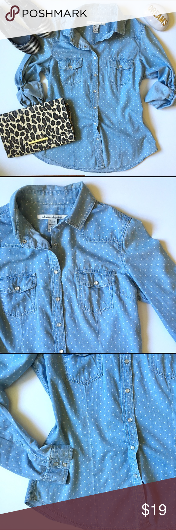 """American Rag chambray polka dot button down top Such a classic piece and a must-have for every wardrobe! This chambray button down features snap closures, two bust pockets, optional rolled sleeves with button tabs. Polka dot. Cotton. 25.5""""L. 19"""" bust laying flat and buttoned. Size Medium. *Pants shown are also for sale in my closet, buy the look and save! **Stock photos for styling ideas only. American Rag Tops Button Down Shirts"""