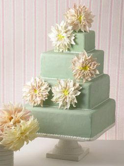 The incredibly realistic-looking dahlia blossoms on this pistachio-colored wedding cake are actually fashioned from white chocolate. Cake design by Chocolate Blossom Cakes.