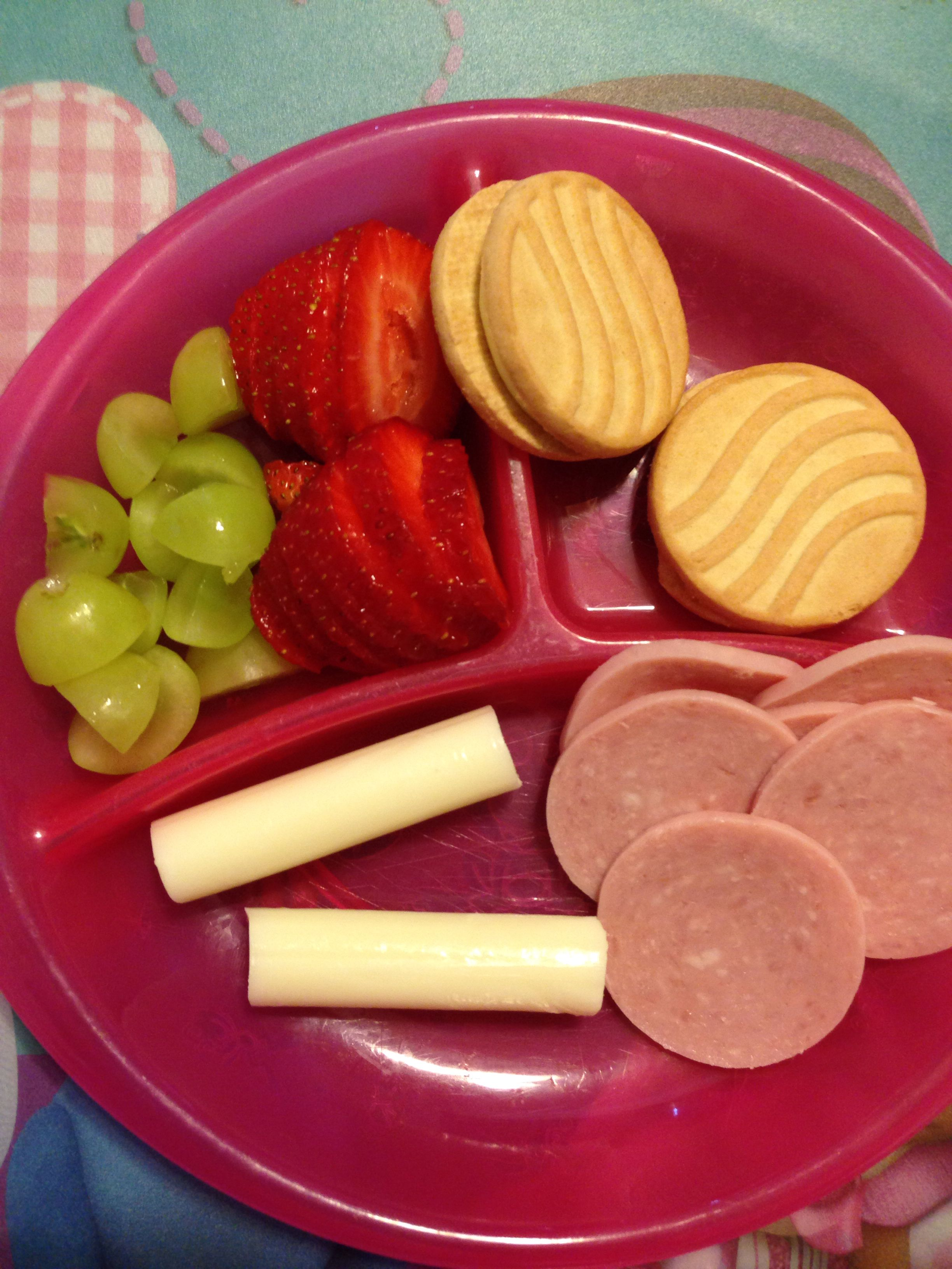 Toddler approved lunch! Ham, strawberries, grapes, cheese stick, 2 cookies.