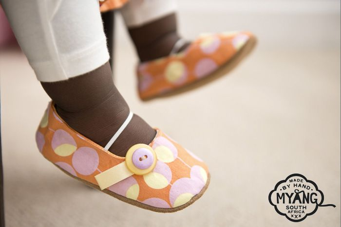 Girls Pumps - Orange and Pink. Non-slip, suede soles and trendy fabric uppers, the perfect first shoe. Our fabrics and trims are carefully selected, to create a shoe that is unique and truly special.