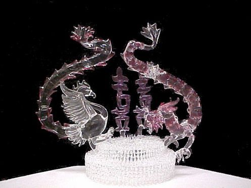 Chinese dragons wedding cake top all genuine hand blown glass phoenix and the Dragon.  I really want it!  $225