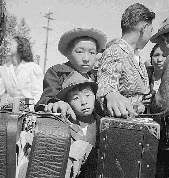Japanese being moved to internment camps.