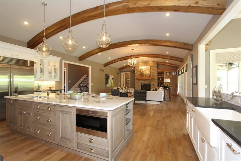"Clayton Douglas Homearama 2014 home ""Bella Noelle"" Additional photo of kitchen/living room  view of exposed beams"