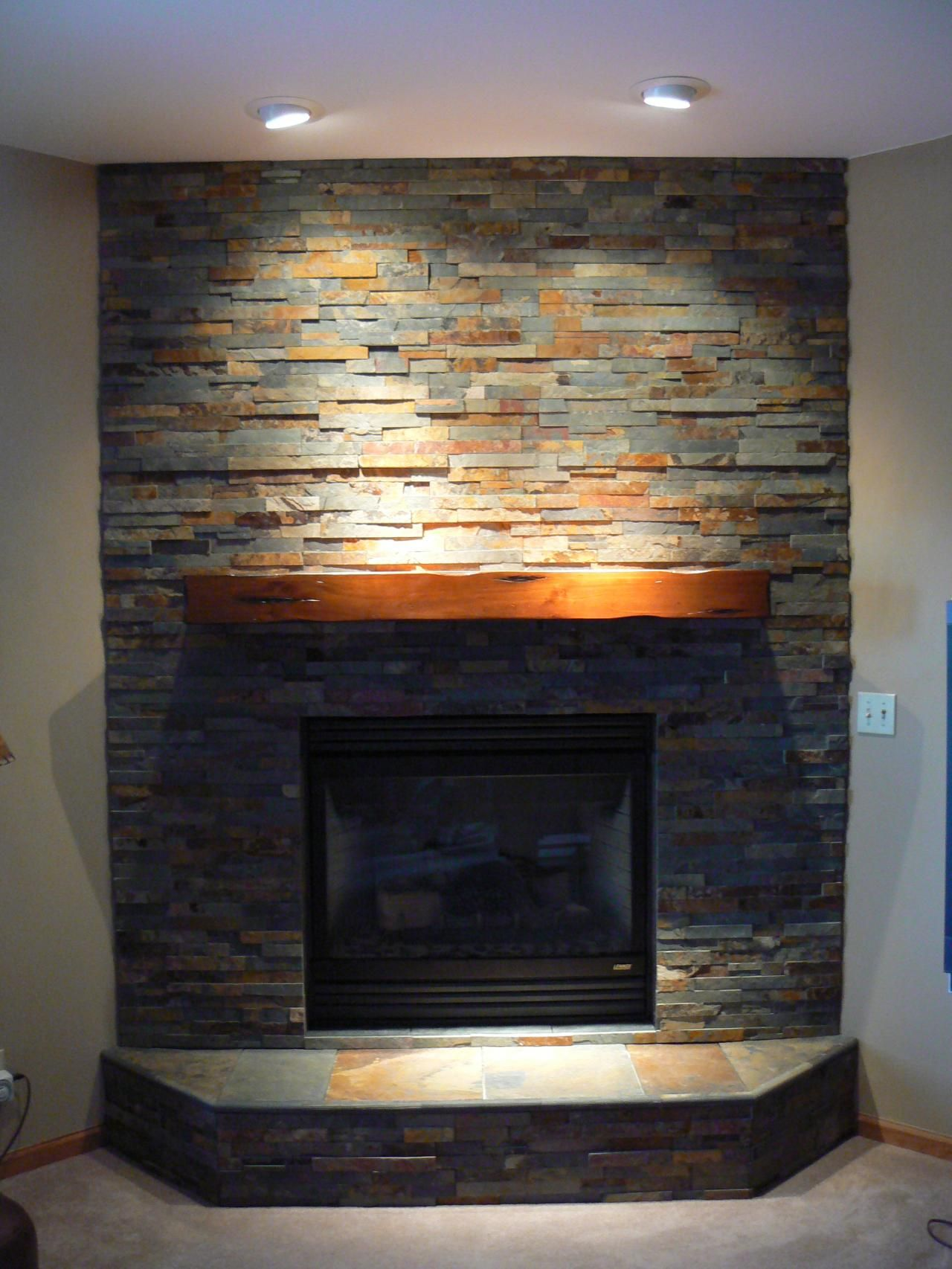 Slate fireplace surround on the level home remodeling Corner rock fireplace designs