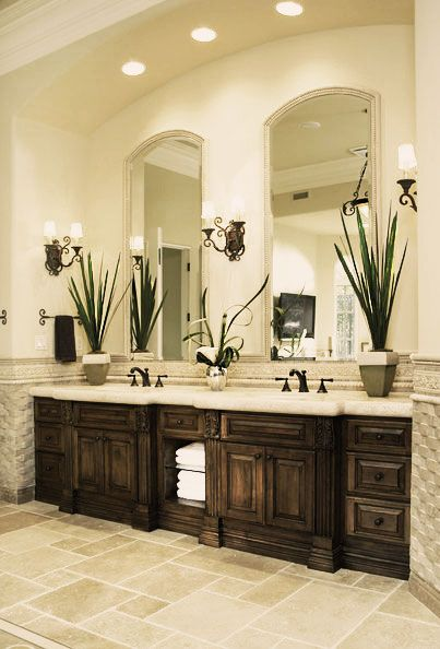 Neutrals in the old world master bedroom and bath are ...