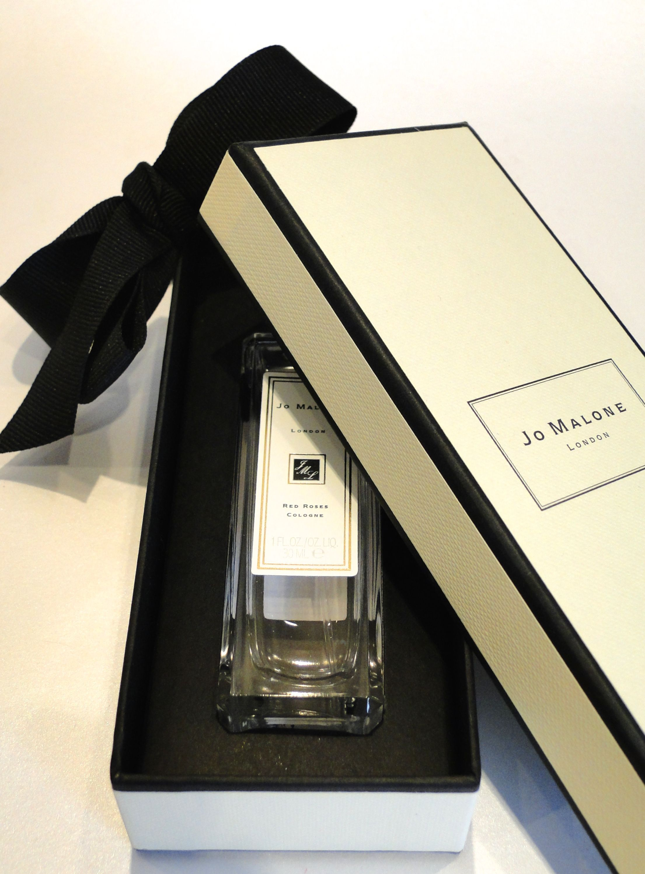 Jo malone red roses cologne box held together by a ribbon