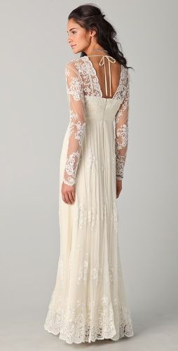 the back of this wedding gown is GORGEOUS!