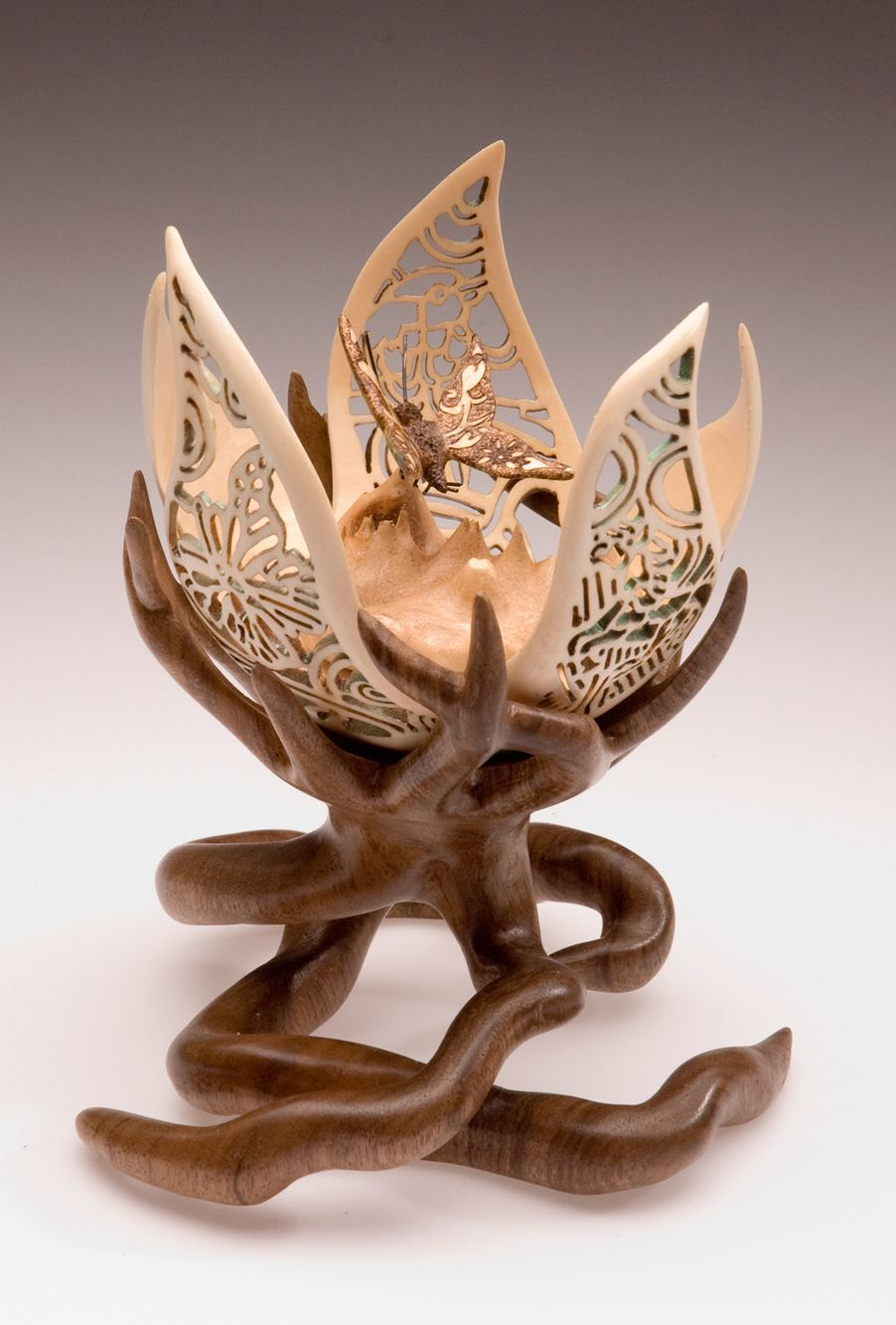 Infancy. Interesting combination of carved/polished wood and fretwork