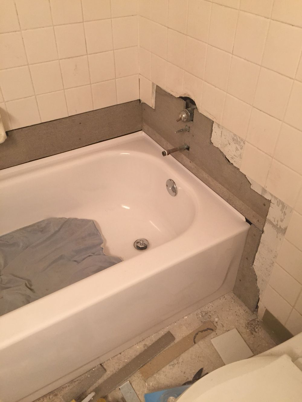 Plumbing fixed....new tub inserted, adding durarock to build the ...