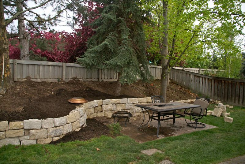 Retaining Walls For Sloped Backyards | Sloped Hill In Our Backyard By  Putting Up A Sand Stone Retaining Wall .