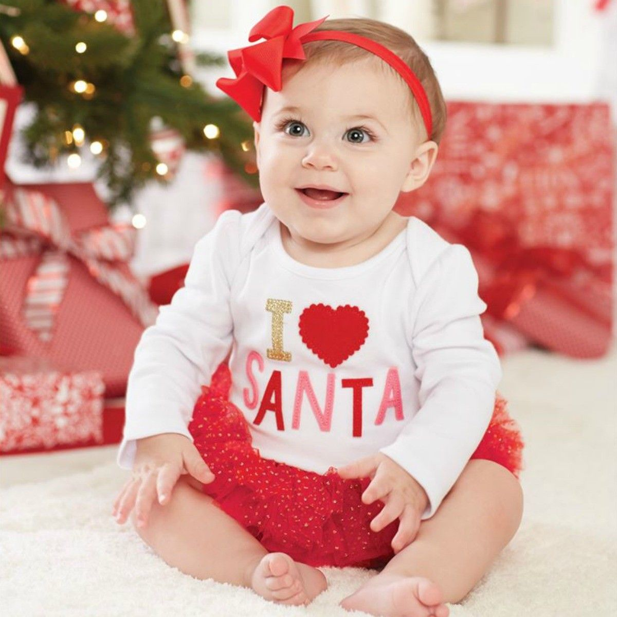 """This """"I Love Santa"""" tutu crawler will have everyone's Christmas spirits high. Your little one will look adorable crawling around in this piece. #tutu #santa #christmas #winter #smile #sakids #smockedauctions"""