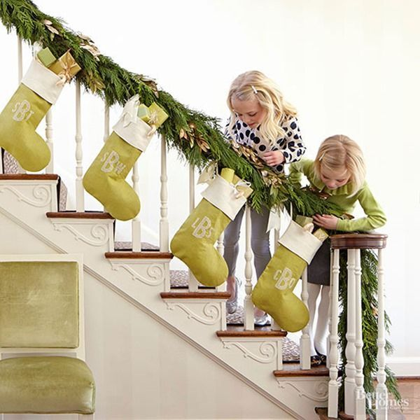 Simple stockings and garland along staircase