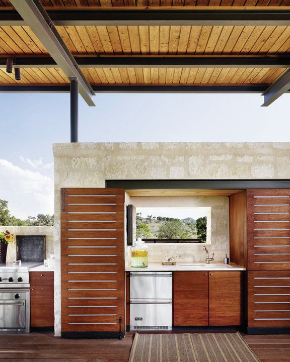 Designed for frequent entertaining, the full outdoor kitchen includes a grill, oven, dishwasher, refrigerator, and sink.