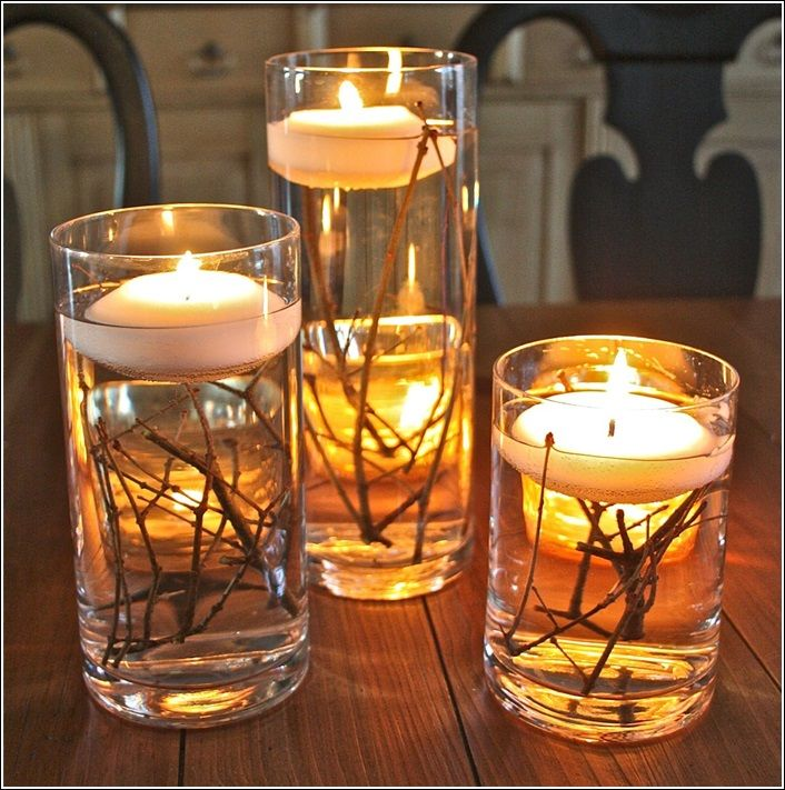 Awesome Candles Over Branches Immersed In Water Centerpiece