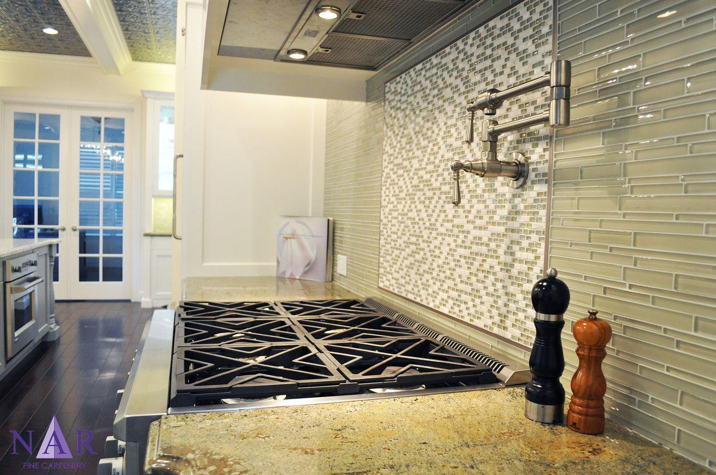 Range detail mosaic tile backsplash with accent tile behind range range detail mosaic tile backsplash with accent tile behind range pot filler and dailygadgetfo Gallery