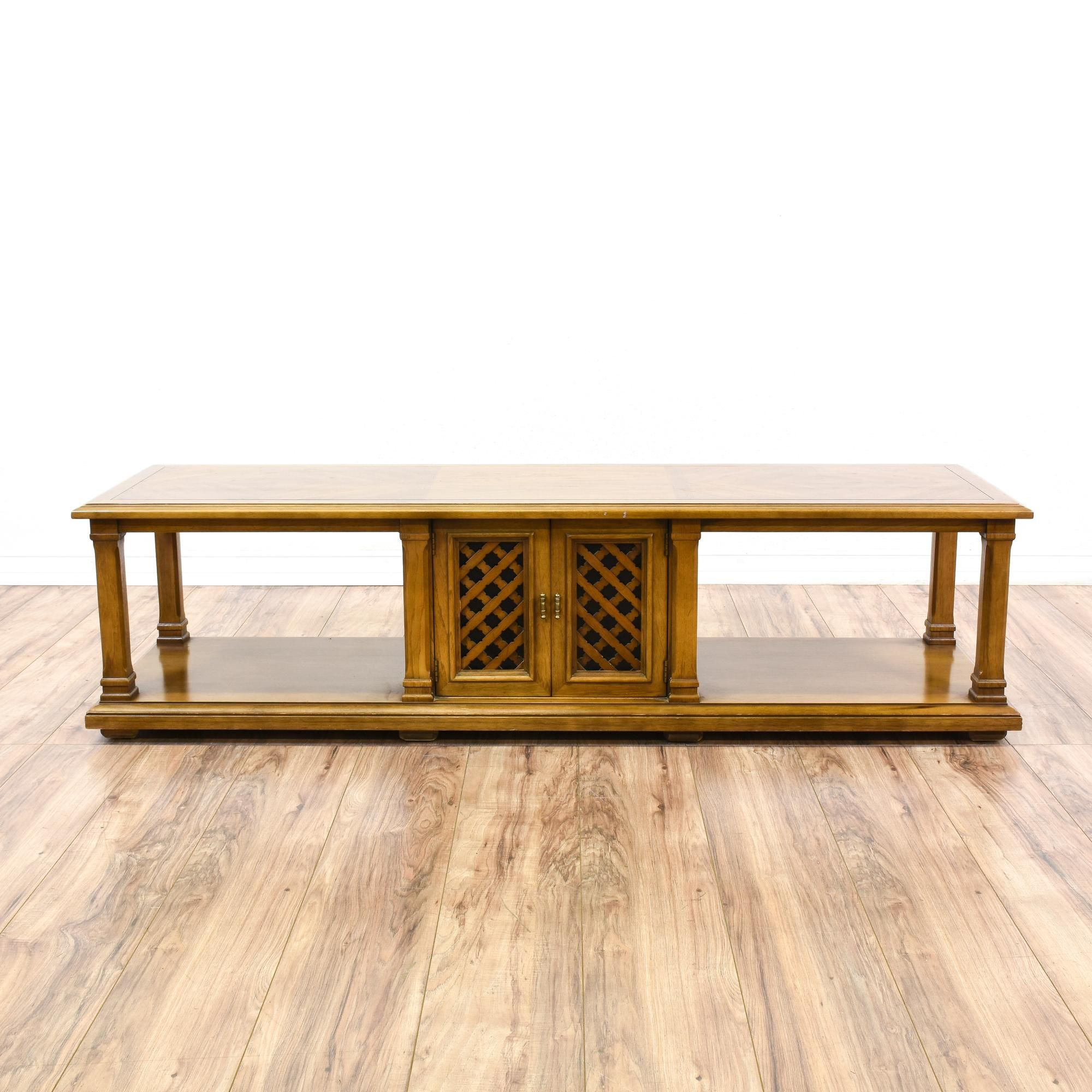 This coffee table is featured in a solid wood with a glossy oak