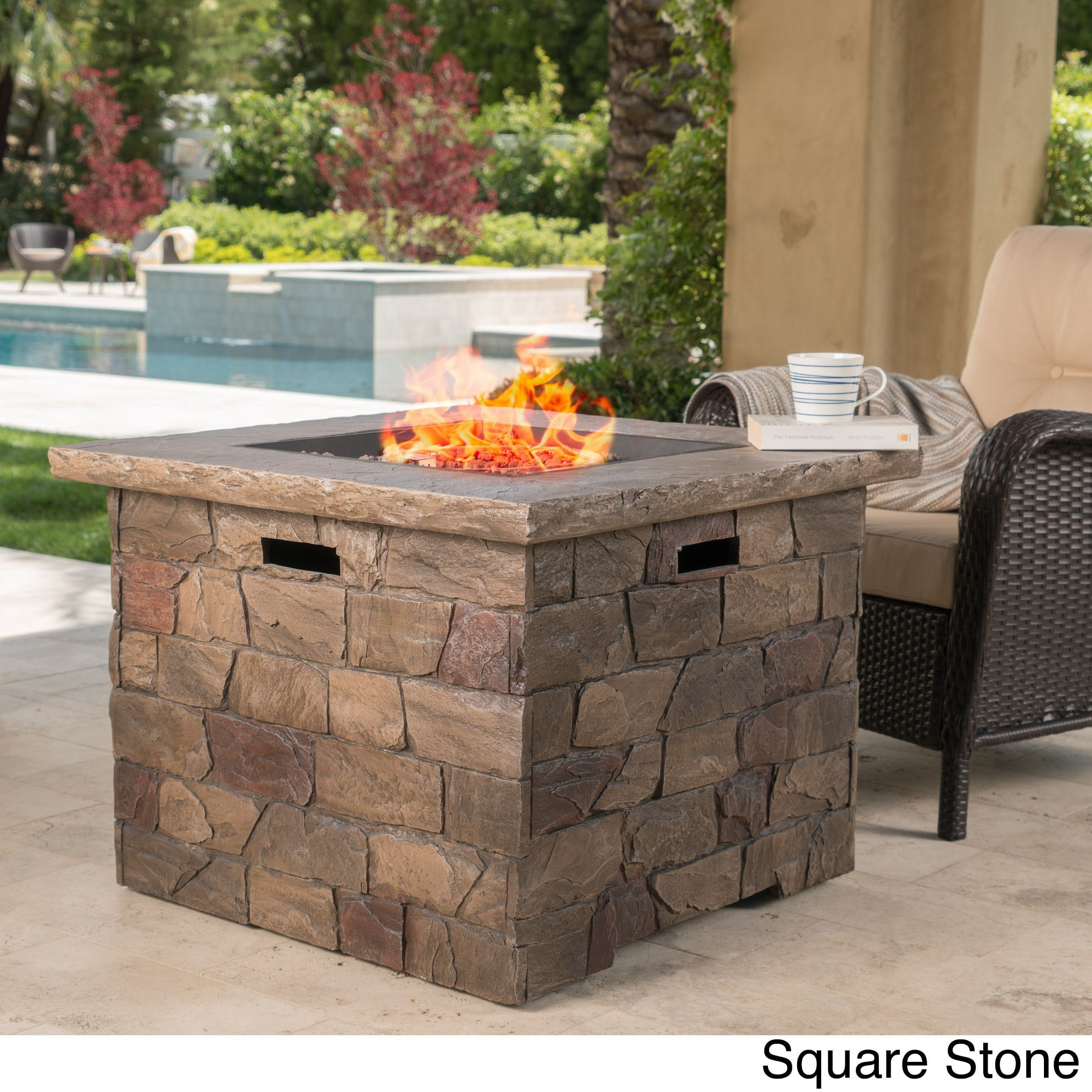 stillwater outdoor natural stone propane fire pit with lava rocks by