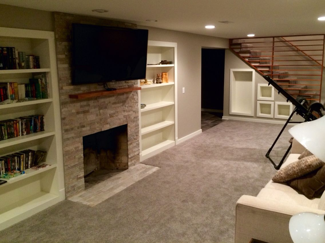 Stack Stone Fireplace With Built In Bookcases Opens To Storage Behind Fireplace Built Ins