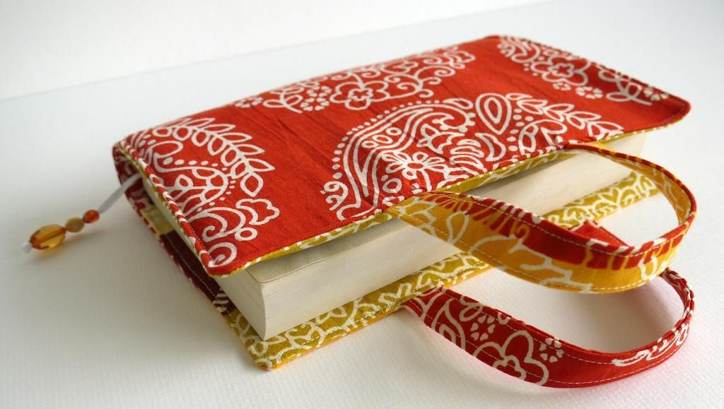 I think I will make a couple with some scrap fabric, minus the handles - I see pretty journal covers in my future!