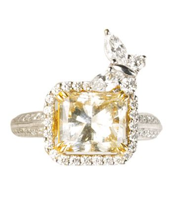 princess cut and pave' diamond ring.. Little butterfly makes this giant bling whimsy.  So fantastic!
