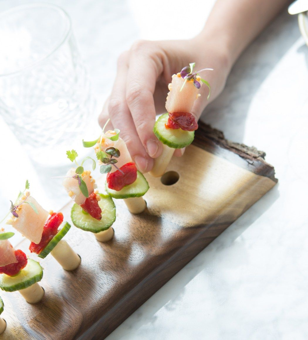 smoked hamachi pipette: tomato raisins, pickled cucumber, thai chili, coconut soy vinaigrettE, applewood-smoked hamachi.