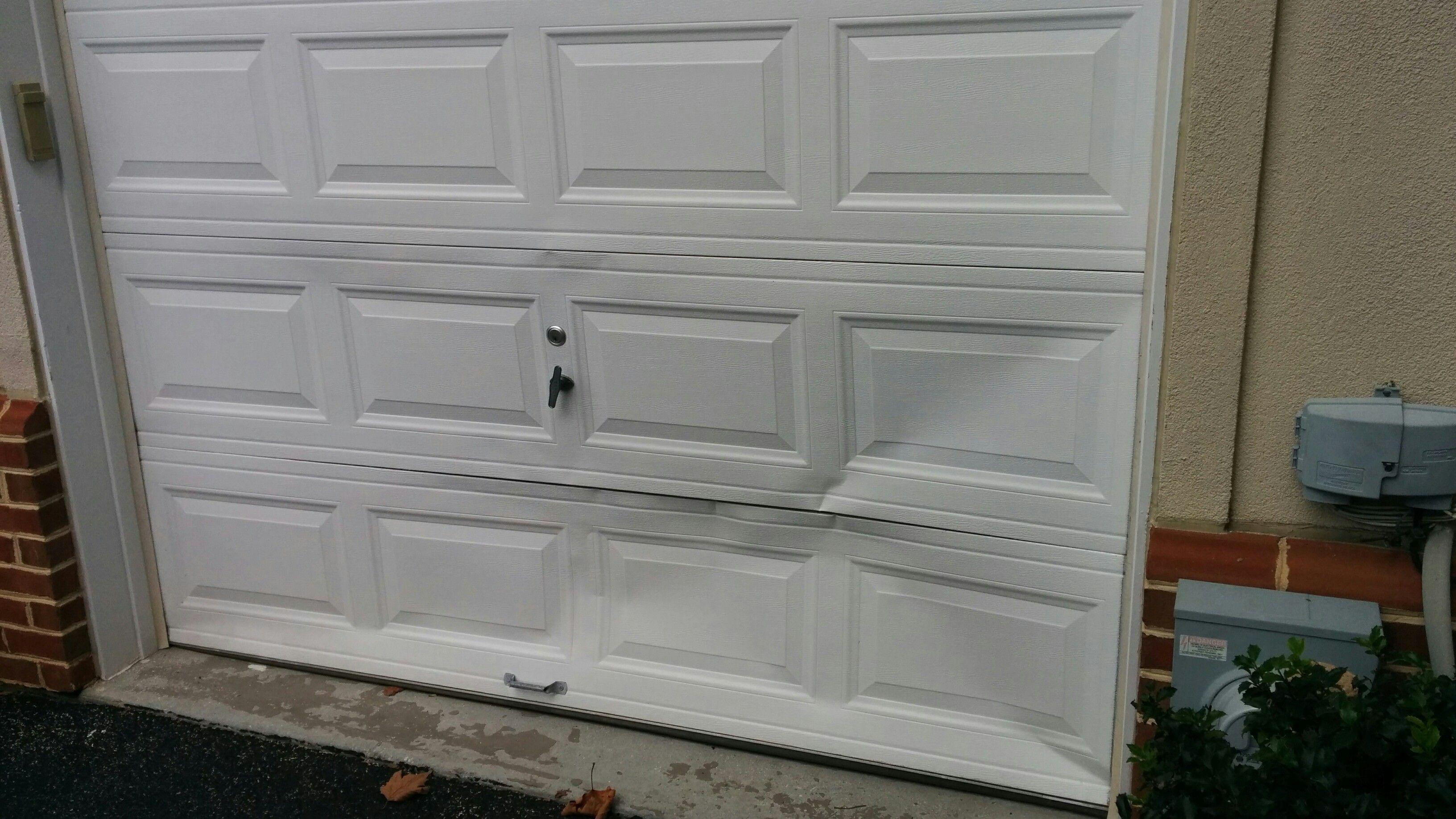 7 Ways To Fix A Dent In A Garage Door Panel Garage Door Installation Broken Garage Door Garage Doors