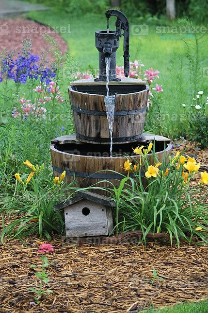 Replace fake waterfall w an old hand pump mounted on a for Yard pond pumps