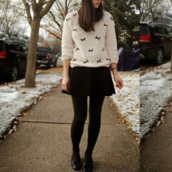Cream sweater with black bows! Thus fluffy cream sweater is super cozy and has adorable black bows on the front! There is a slight shimmer in the knit. Offers welcome  Phase One  Sweaters Crew & Scoop Necks