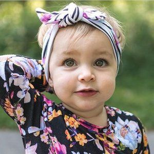 Those sweet eyes ! How sweet is miss Piper in our floral stripe top knot headband? Our stretchy top knot headbands are one size fits all so mommy & me can share!  #toddlerfashion #mommyandme
