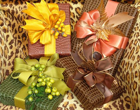 Animal print papers with bright ribbons, berries, and pinecones