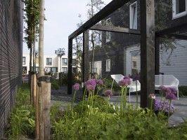Plexiglas Windscherm Tuin : Een pergola met een plexiglas windscherm tuin