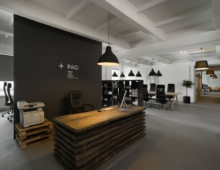 That desk! I WANT!! It's made of wooden boards obtained after the demolition of a 100-year-old house.    From the head office of the Pride and Glory Interactive agency.