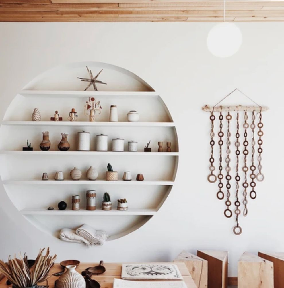 built-in circle shelves with neutral ceramics at the general store. / sfgirlbybay