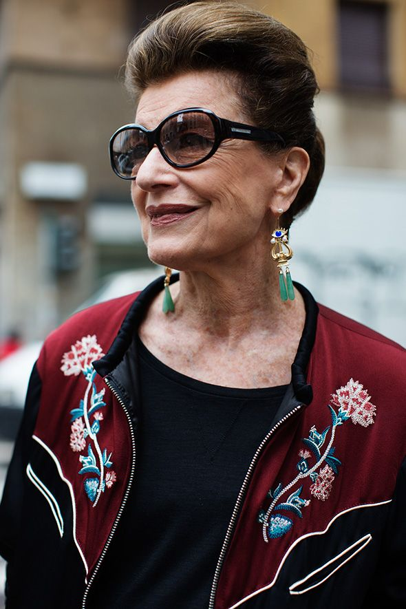 This is not an example of a fabulous older glamazon, BUT it is one of the rare photos of an older woman at Fashion Week in Milan.  We are invisible.