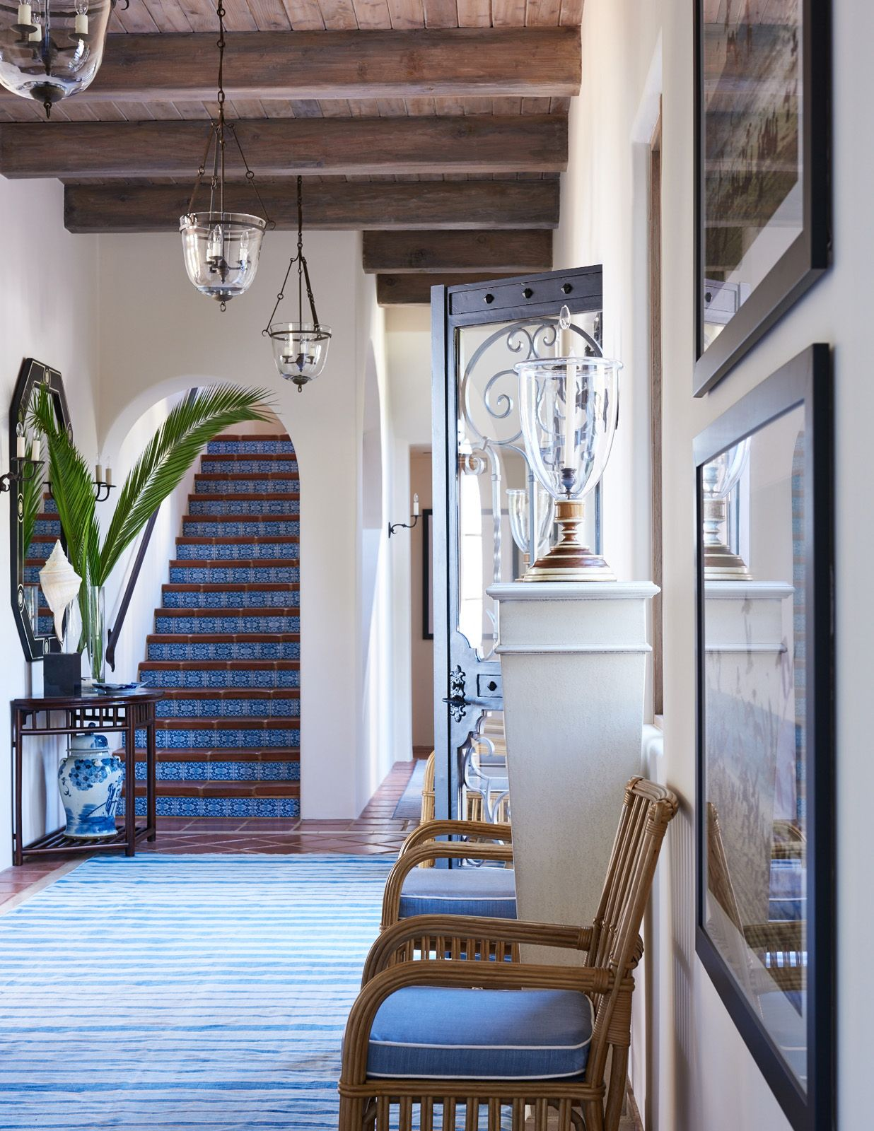 Coastal Entry With Stairs Covered In Tile To Match The Decor Hues