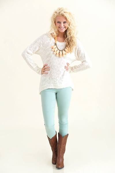 Pale blue jeans with white top, brown boots