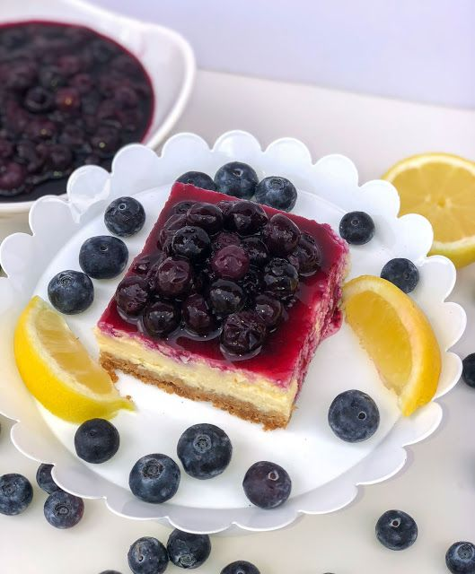 Lemon blueberry cheesecake bars recipes. Lemon cheesecake with blueberry topping and graham cracker crust. #lemonblueberrycheesecake