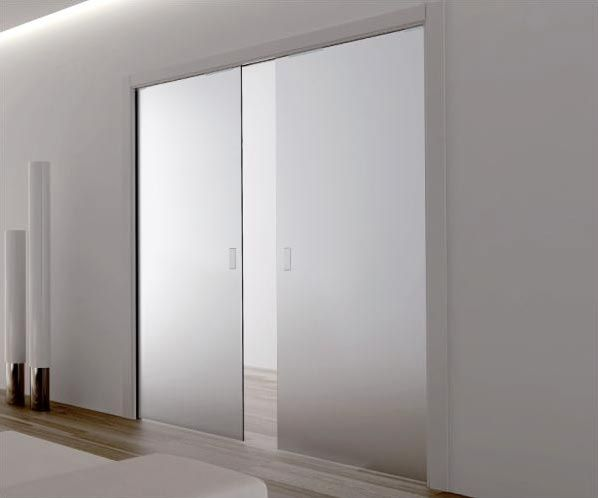 Master suite frosted glass double pocket doors home for Double pane sliding glass door