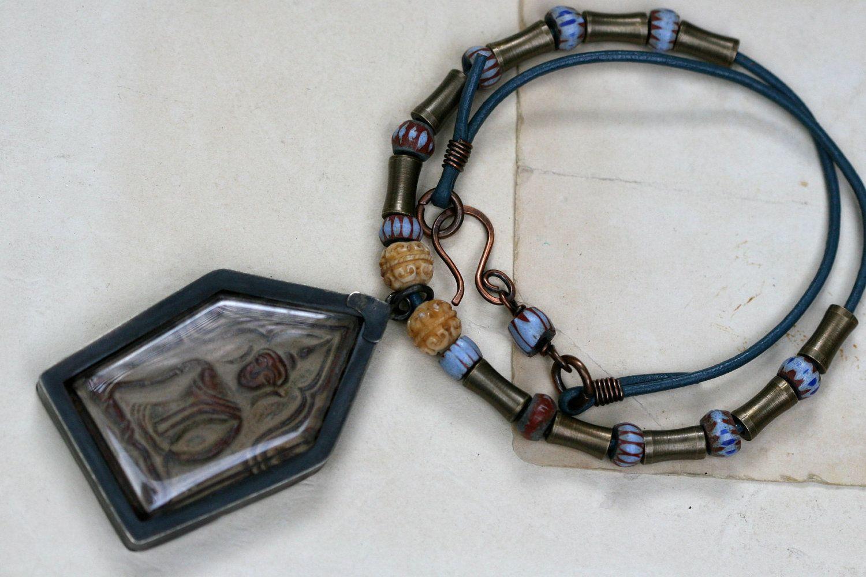 Buddhist Temple - Necklace-Rustic, Budha Temple Neckpiece, Large Pendant,Boho, Blue, Leather,Tribal,African Beads,Metal Beads,Antique,Bone. $75.00, via Etsy.