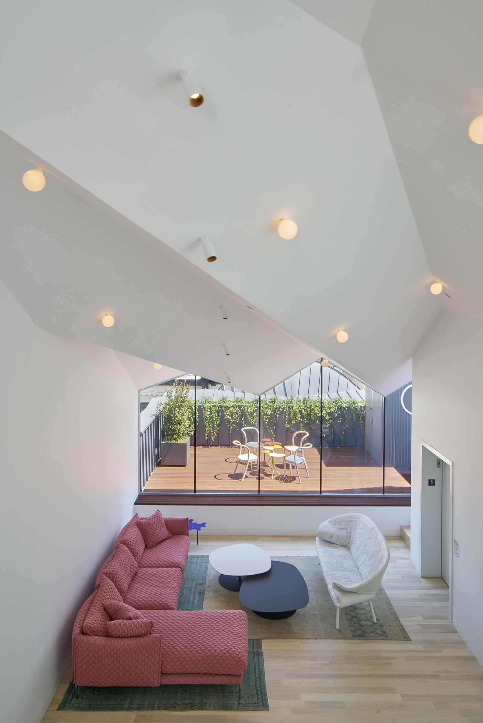 Entertainment and dining spaces sit below the