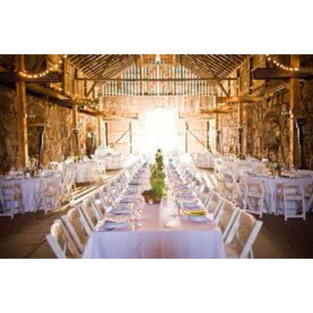Barn wedding rectangular long table and round tables together