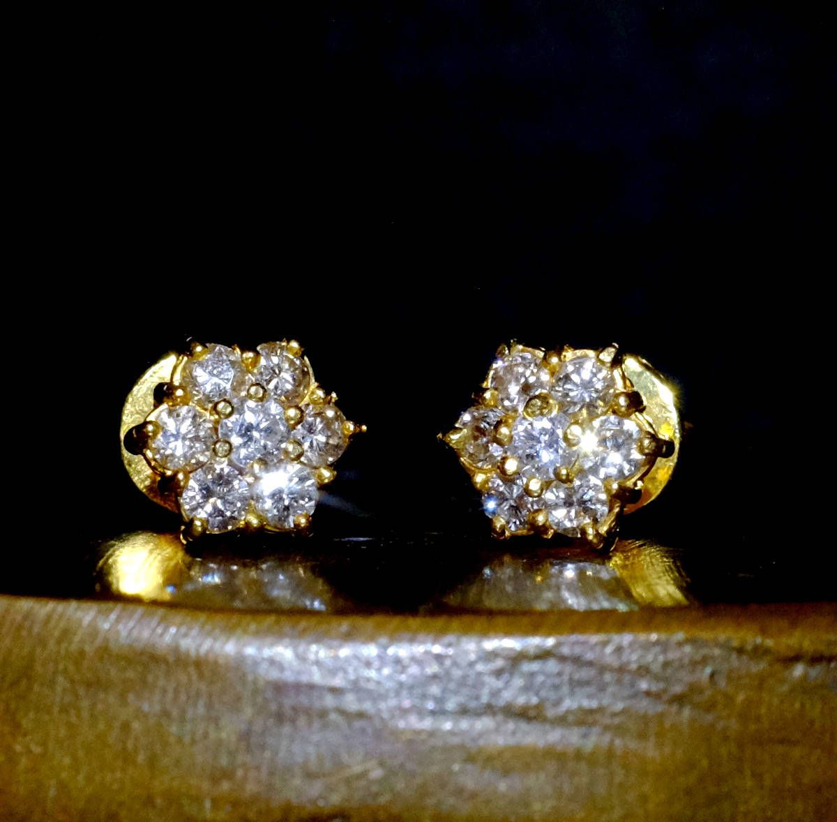 8c4f58f49 Small diamond stud earrings set with 7 diamonds in 20k. These small  diamonds are set very well, for a small pair of studs. The effect of gold  and whi.