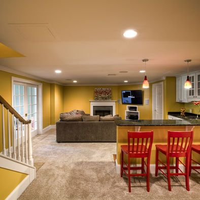 half wall with counter top and chairs. french doors into ...