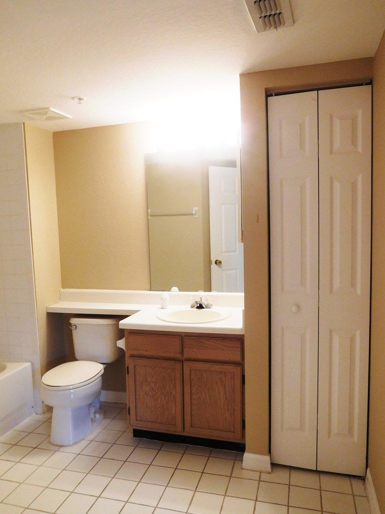 Bathroom Cabinets Naples Fl 2nd bathroom with wood grain vanity, linen closet, & combo tub
